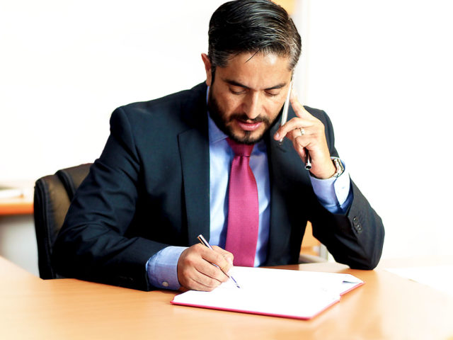 Man talking on phone at desk