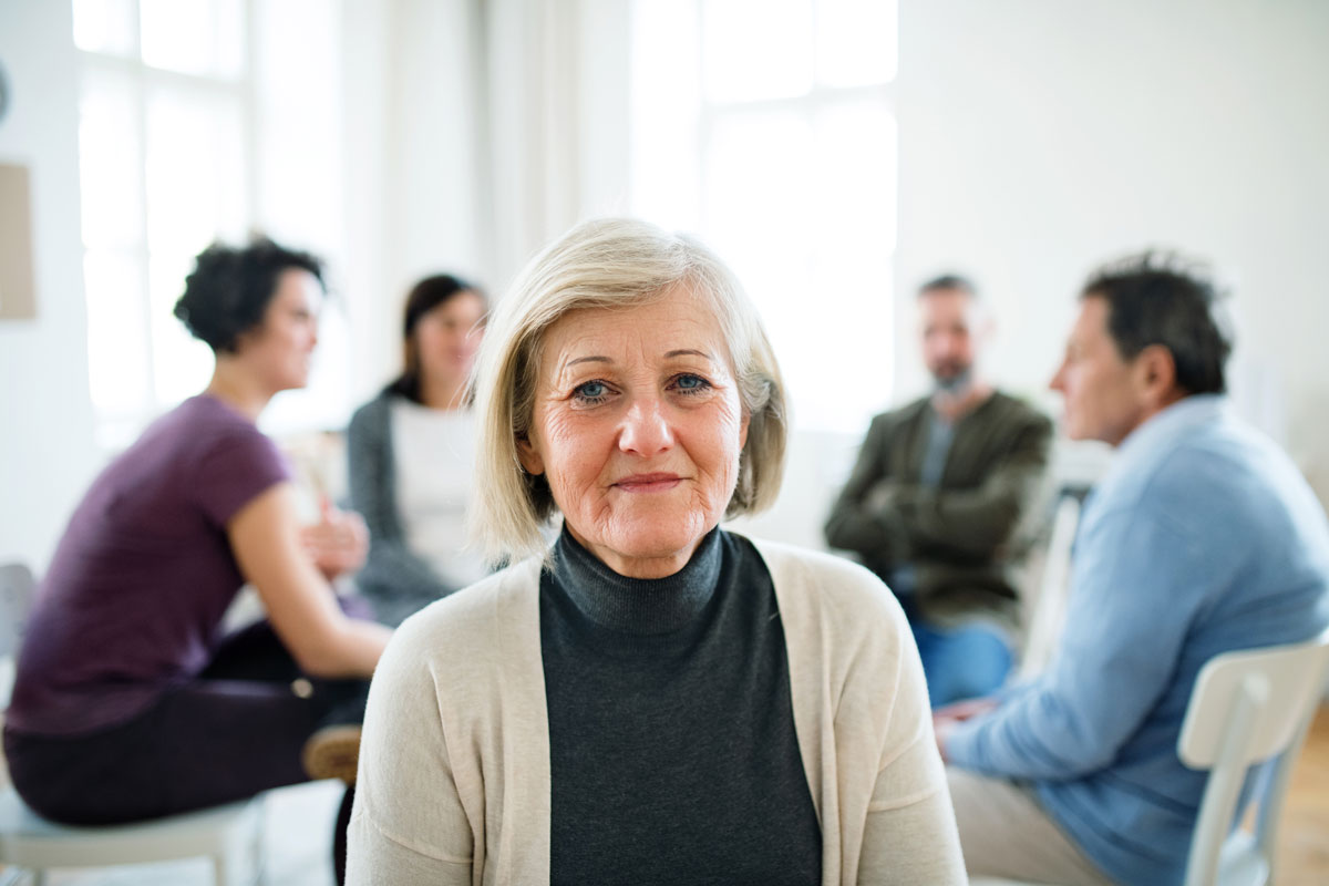 Woman in a Group Therapy Setting for Addiction Treatment