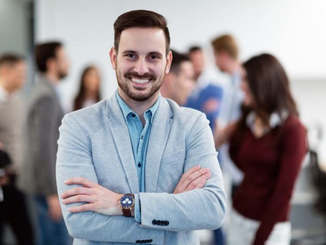 Group picture of businessman posing in office