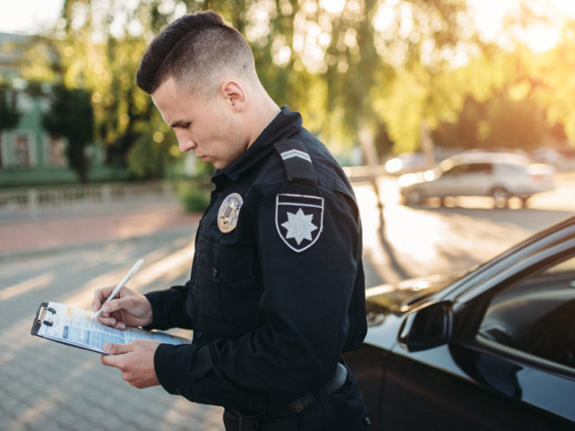 male cop doing paperwork