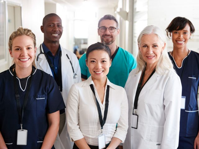 portrait-of-medical-team-standing-in-hospital-